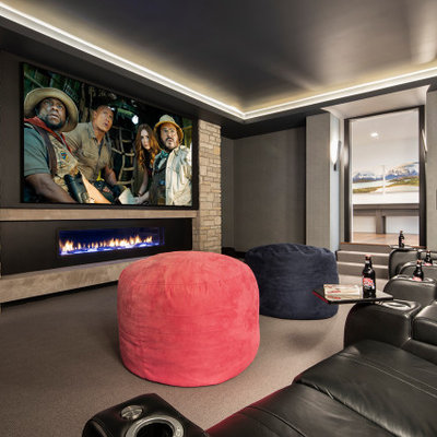 Example of a mountain style home theater design in Minneapolis