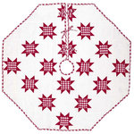 "VHC Brands - Emmie Red 55"" Patchwork Tree Skirt - Countrify your Christmas this year with the 55"" Emmie Red Patchwork Tree Skirt. A holiday significant 7 rows of 8-point stars are placed on a bright white background. Reverses to the red and white check found inside the stars. 100% cotton, hand-quilted."