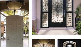 Iron in Glass door insert with matching sidelights and transom.
