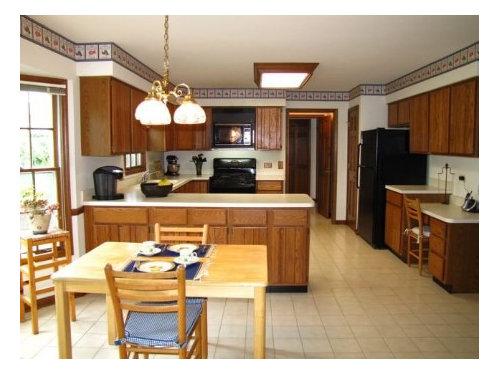 Color For Granite Countertop On Honey Oak Cabinets