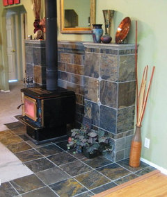 here is a mantel i designed for a free standing wood stove a few years back we used a combination of 12x12 slate tiles slate chair rail tile and metal
