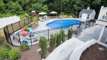irregular shaped swimming pool with  stamped concrete patio