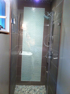 Tiled in shower to tub conversion. Tile vs. tub surround?