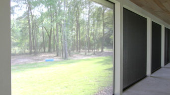 Florida Farmhouse Porch with Motorized Retractable Screens from DiscoverShade