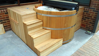 Cedar Hot Tub installation with custom made stairs and enclosure