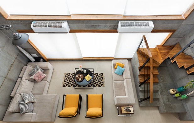 Contemporary Living Room by Studio Nishita Kamdar & See how professionals take advantage of double-height living room.