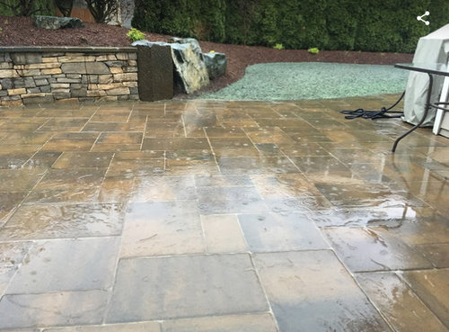 is it normal to have this water puddle on pavers?