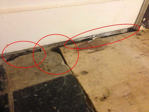 How to seal big gaps in concrete / plywood subfloor