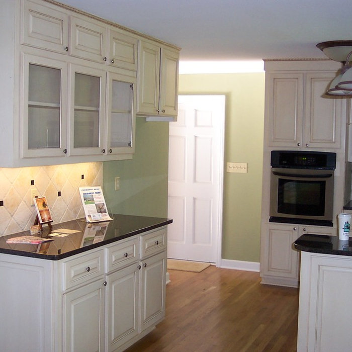 Pamela Foster:  We totally gutted this kitchen, removed the roof and raised the ceiling heights to 10'.  We also pushed out the back another 15' to make a large open space for the kitchen and new brea