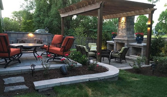 Outdoor Fireplace, 2 level patio, retaining walls and an outdoor kitchen