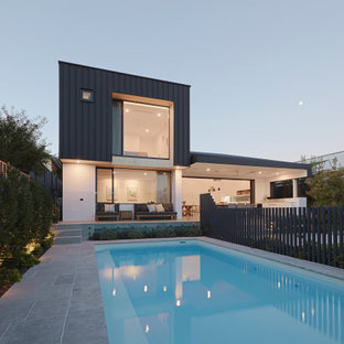 Inspiration for a modern backyard rectangular lap pool in Perth with tile.