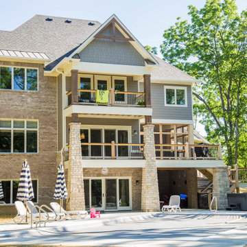 Two Story Stone Home with Great Outdoor Living Space