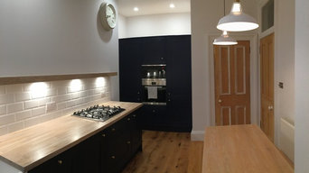 Dark blue cabinets and integrated appliances