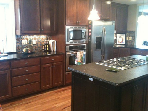 How Can I Brighten Up My Dark Kitchen My Kitchen Has Black Granite Counter Tops And Dark Stained Cabinets With A Talavera Tile Back Splash I Love T