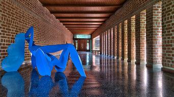 The Long Verandah & Deep Walkway, featuring a blue Dhruv Mistry iron sculpture