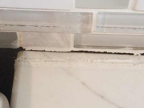 Cabinets Pulling Away From Wall