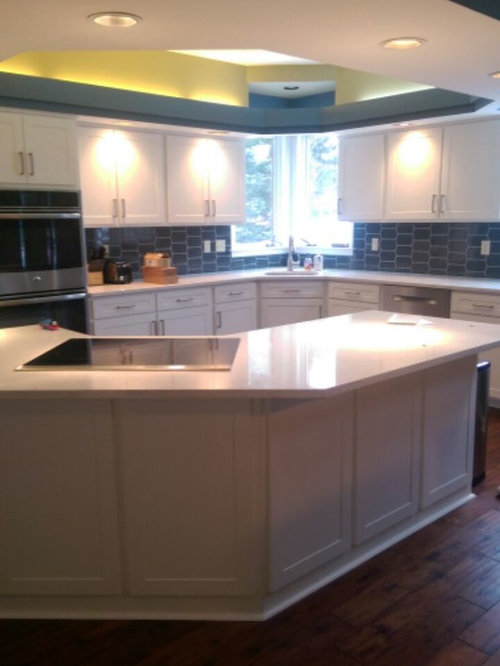 cabinet refacing--white with tile backsplash and quartz countertops