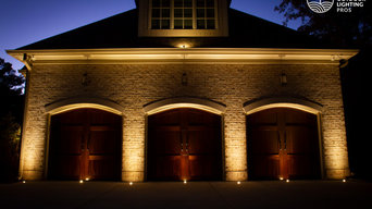 Illuminating the rich wood doors helps to welcome the family home safely