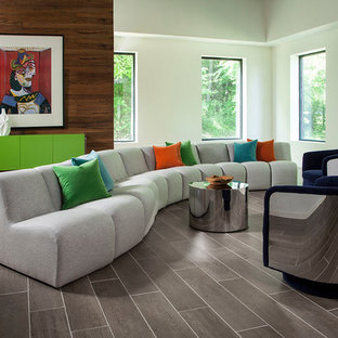 Living room - midcentury modern open concept gray floor living room idea in Other with white walls