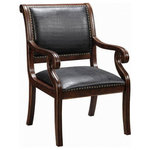 Coast to Coast - Chair - This accent chair has plenty of flair in a traditional and attractive package. The Rich Textured Brown finish is adorned with plenty of hand carved details that enhance the curved back, arms and legs. The seat and arms are covered in a Black Leather-like Embossed Alligator and framed by decorative nail head trim.