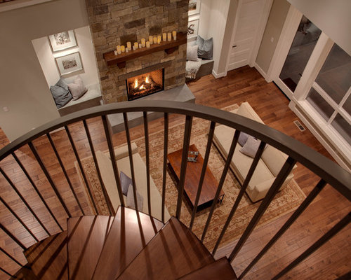 Example Of A Large Trendy Wooden Spiral Open Staircase Design In Seattle