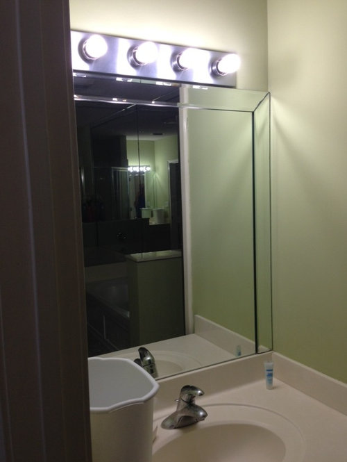How to remove beveled frame on mirrors.