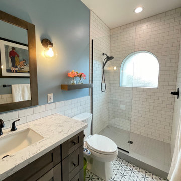 Kids bathroom remodel with intricate tile flooring
