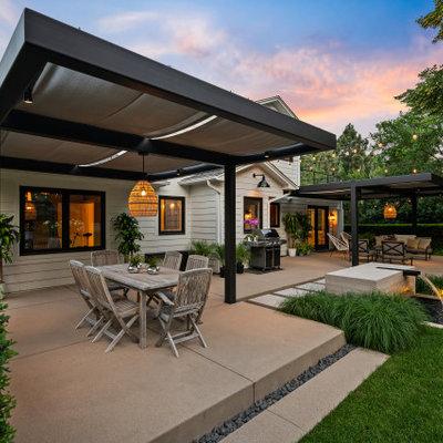 Farmhouse home design photo in Denver