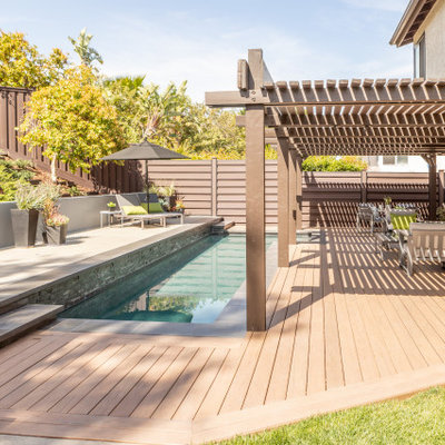 Trendy rectangular pool photo in Los Angeles with decking