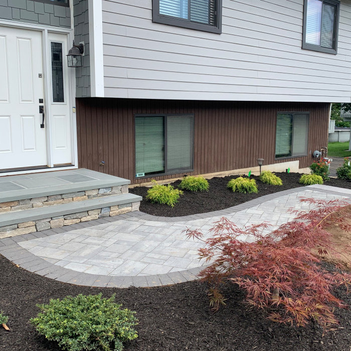 Paver walkway with bluestone landing, surrounding landscape design