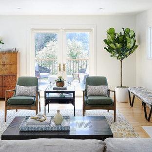Idéer för ett mellanstort modernt allrum med öppen planlösning, med ett finrum, vita väggar, mellanmörkt trägolv och en standard öppen spis