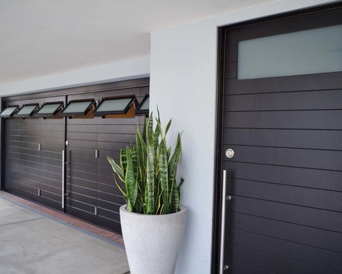Modern 6 Fold Carriage Garage Doors With Matching Entry Door