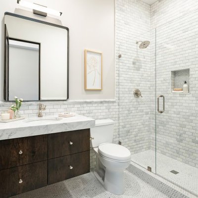 Alcove shower - mid-sized transitional white tile and marble tile porcelain tile, gray floor and single-sink alcove shower idea in Phoenix with flat-panel cabinets, dark wood cabinets, a one-piece toilet, gray walls, an undermount sink, marble countertops, a hinged shower door, white countertops and a floating vanity