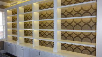 Custom, backlit bookcase and base cabinets