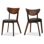 Interiors Wholesale - Sumner Black Faux Leather And Walnut Brown Dining Chair Set of 2 - The Sumner walnut veneer dining chair absolutely radiates style and a little bit of retro charm. With dainty legs and a flawless silhouette, this is a chair set that will match basically any table, and be at home in any dining room. Sumner is a true testament to Scandinavian design - clean, crisp lines give way to curved features and gorgeously finished tapered wood legs. Practical yet stunning, it can find a place in any home. The Sumner dining chair set presents itself with a trendy walnut finishing, which is both neutral and eye catching. This luxurious finish emits an air of sophistication, and leaves a smooth, easy to clean surface. Made in Malaysia, the Sumner dining chair requires assembly.