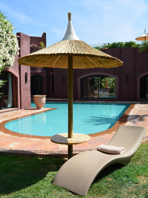 Am nagement piscine parasol naturel en paille for Amenagement piscine