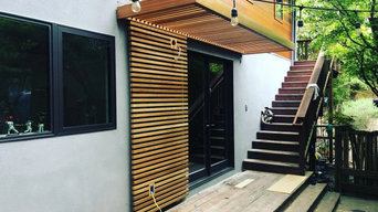 Entry wooden awning and wooden paneling