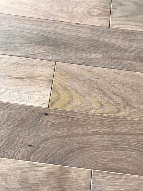 Brand New Hardwood Floor Turned Yellow In Spots After Cleaning