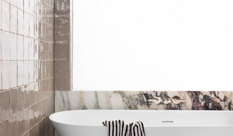 Room of the Week: A Striking Marble Stars in a Family Bathroom