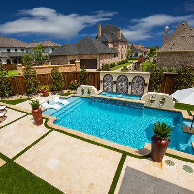 Mid-sized tuscan home design photo in Dallas