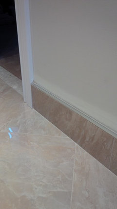 Wood or Tile Baseboard in Bathrooms