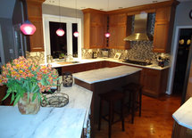 Love the countertops!  Are they Carrarra marble?  Thanks in advance.