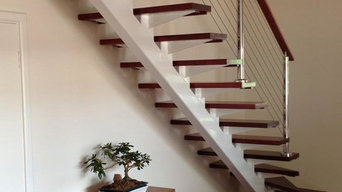 All custom made staircases, this is a steel staircase with timber treads & stain