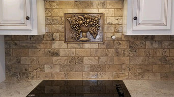 Natural stone kitchen backsplash with decorative insert