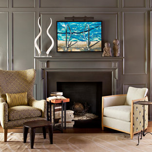 Traditional study in Orange County with a standard fireplace and a metal fireplace surround.