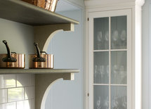 How are the shelf brackets mounted to the wall?