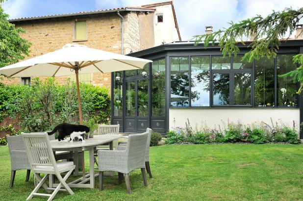 3 cuisines sous v randa se tournent vers le jardin for Amenager une veranda
