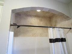 ceramic tile above fiberglass shower