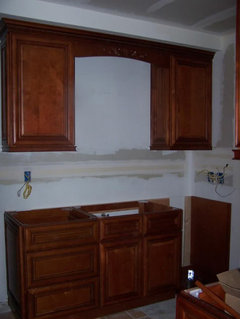 Do any of your new kitchens have wood valance over sink? Wooden Valance Kitchen Cabinets Not Touching on