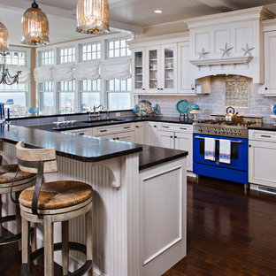 Design ideas for a large transitional u-shaped eat-in kitchen in Other with an undermount sink, recessed-panel cabinets, white cabinets, granite benchtops, blue splashback, subway tile splashback, stainless steel appliances, dark hardwood floors, blue benchtop and coffered.